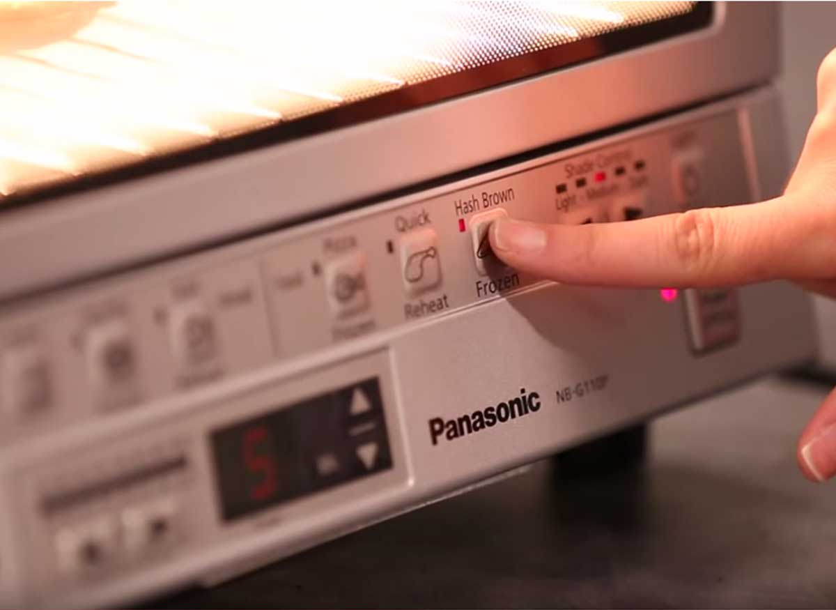 Photo of an interior light function on a toaster oven.