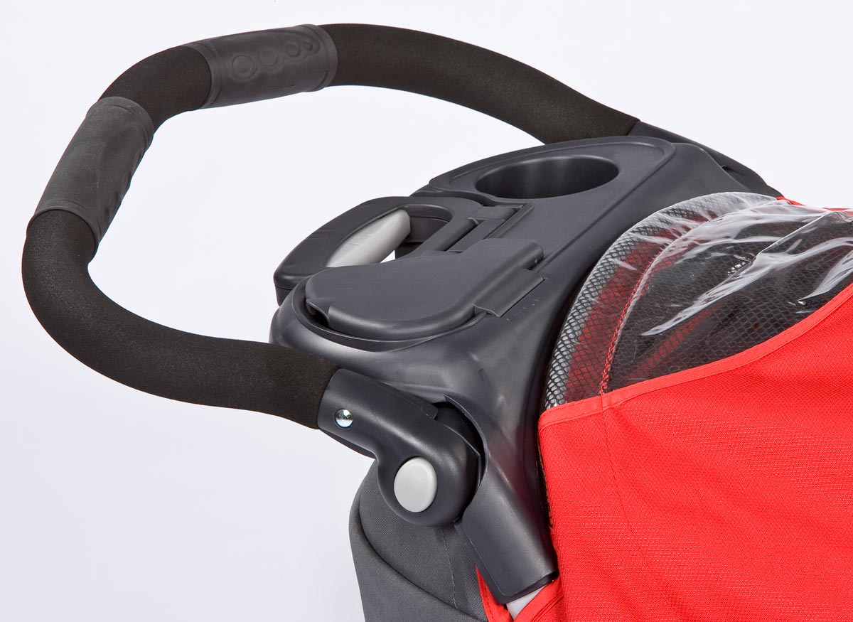 Photo of a stroller handlebar.