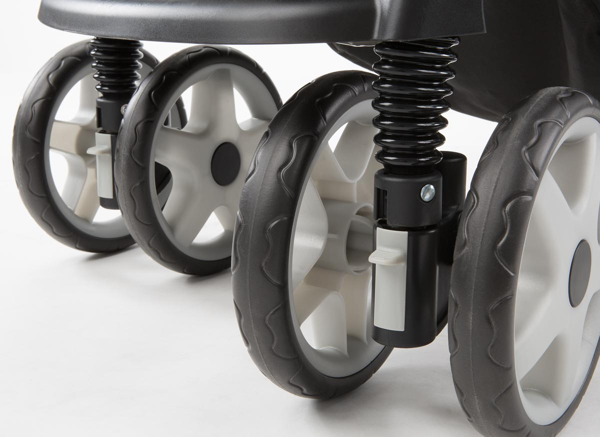 Photo of a set of stroller wheels and shock absorbers.