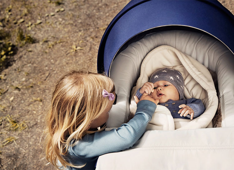 Stokke Trailz stroller with baby and oldre sister.