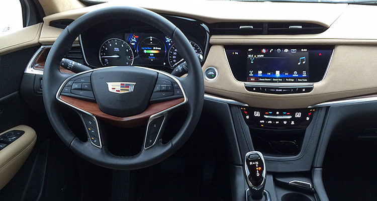 cadillac xt5 suv luxury interior cars fight ready toned feels stitching resplendent cabin rich chrome detailed leather wood consumerreports