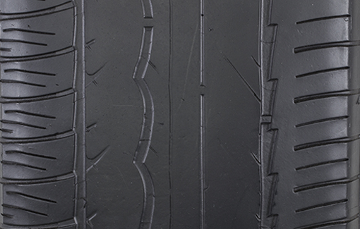 Close-up photo of an over-inflated tire.