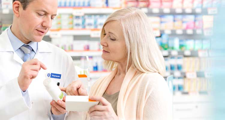 Pharmacy discount. Image of woman talking to pharmacist.