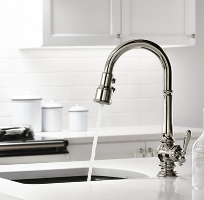Photo of a bar faucet.
