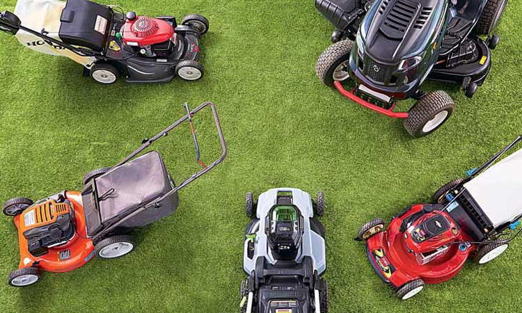 Photo from above of four lawm mowers and one lawn tractor in a circle.