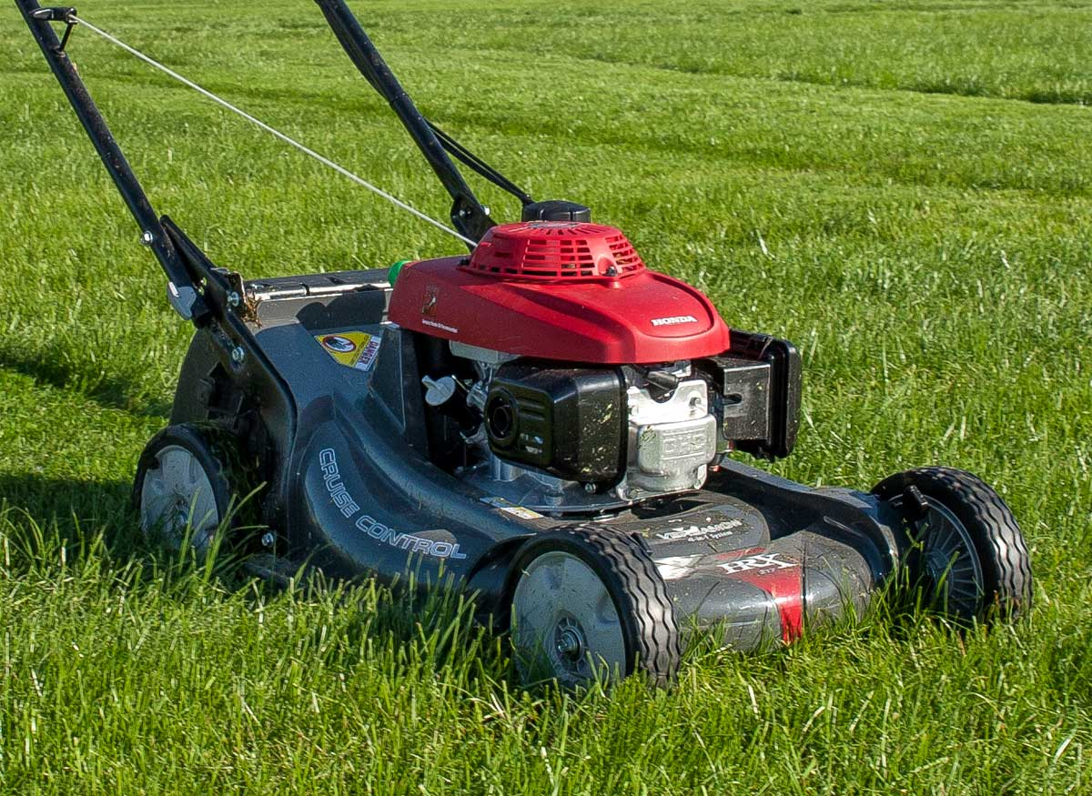 Picture of uniform-sized wheels on a lawn mower.