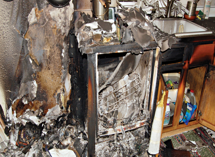 The charred aftermath of a dishwasher fire.