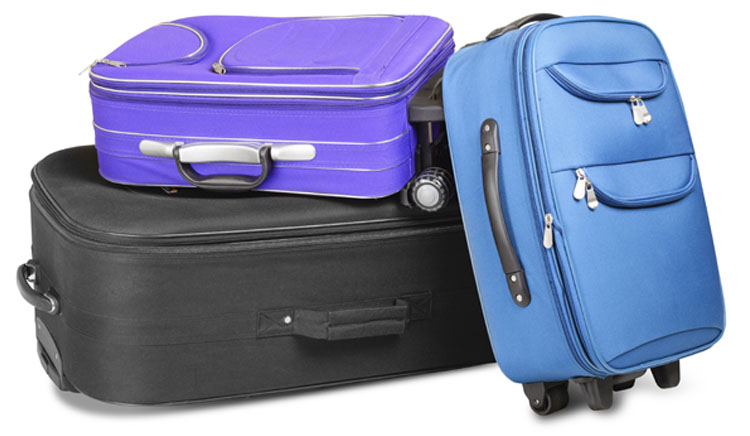 Photo of three different sizes of luggage all piled together.