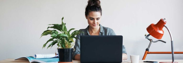 Woman sitting in front of her laptop