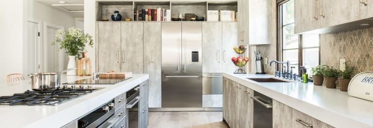 Small built-in refrigerators fit small kitchens.