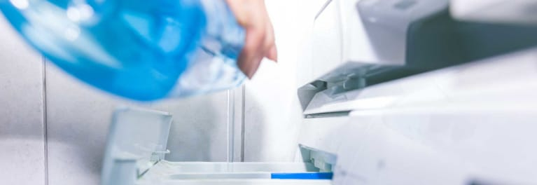 A person using laundry products.