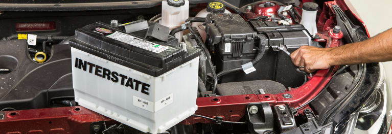 A car battery on an engine.