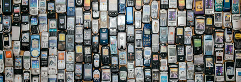 For an article on how to recycle old electronics, this photo shows a pile of old digital gadgets.