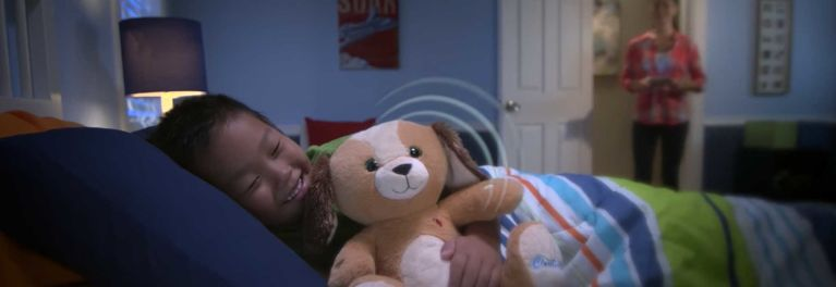 Child sleeping with a CloudPet bear for a story on children's online privacy.