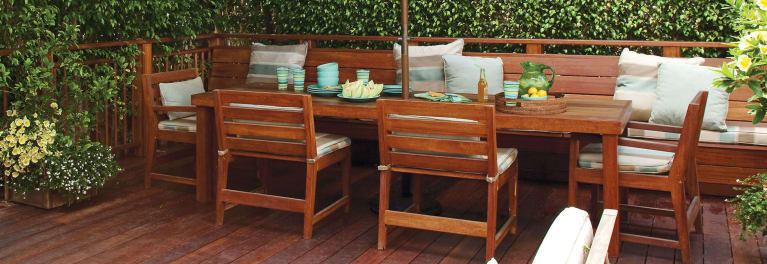 A table and chairs on a deck.