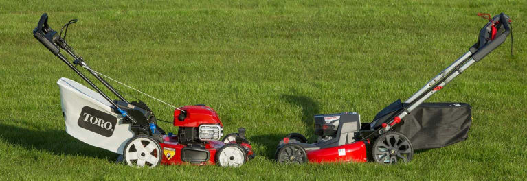 Two walk-behind mowers.