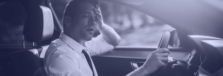 A man driving while drowsy.