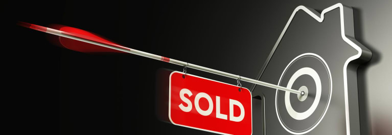 Sold sign on a home with smart-home upgrades.