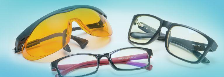 Three pairs of blue blockers: Uvex Skyper safety eyewear, left, Spektrum Pro Blue Light Blocking Glasses, Gunnar Intercept gaming glasses