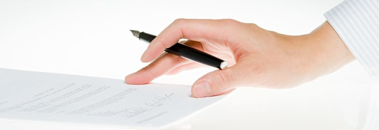 Signing a home remodeling contract.