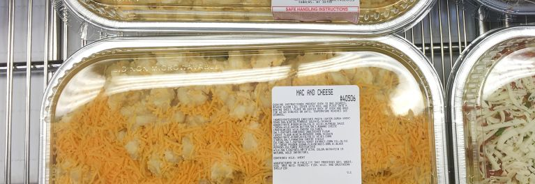 Macaroni and cheese in a prepared foods case.