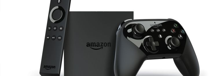 Photo of the new Amazon Fire TV, regular remote control, and gaming remote control.
