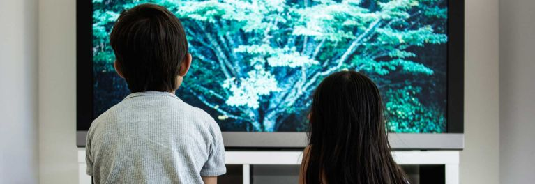 Image of kids watching TV, for a story on the best 4K TVs.