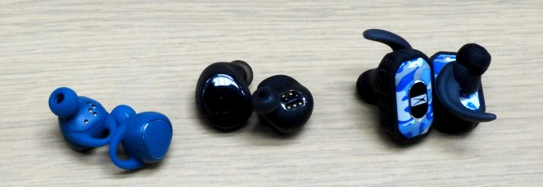 Three pairs of truly wireless earbuds.