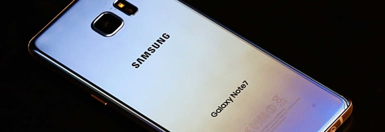 A photo of the back of a Samsung Galaxy Note 7 smartphone, which has been under an official product recall program for flammable batteries. According to reports, the owner of a recently-replaced Galaxy Note 7 said his supposedly-safe smartphone caused a fire aboard an airplane at the airport.