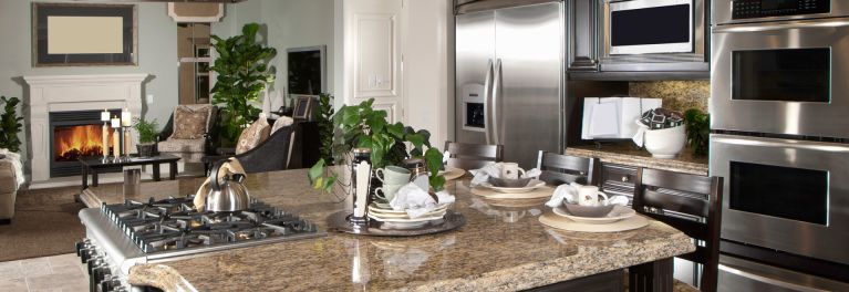Upscale kitchen with innoative appliances.