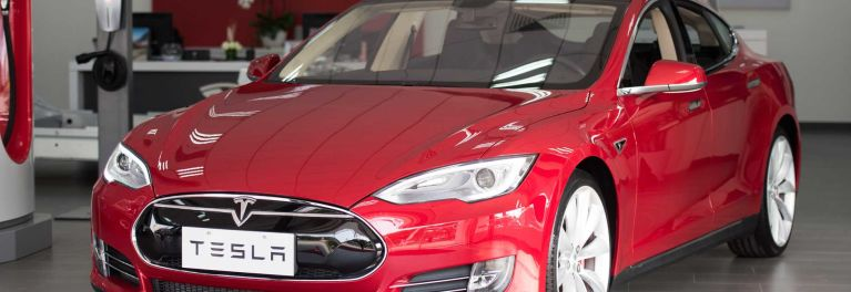 Tesla Model S electric car on a red background
