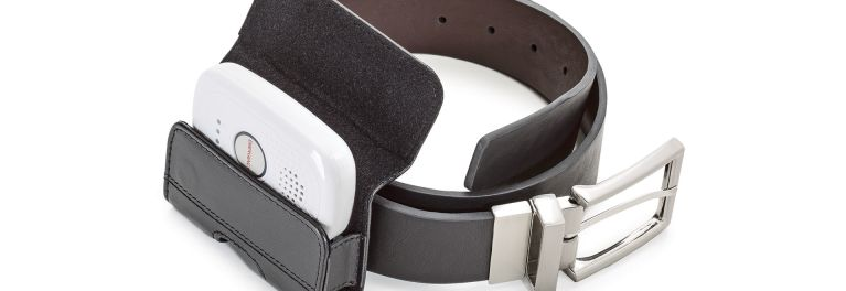 A mobile medical alert device fits in a belt holder.