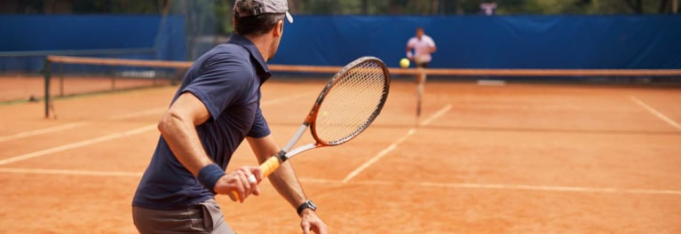 This is a photo of a man playing tennis. Physical activity may help to ease depression.
