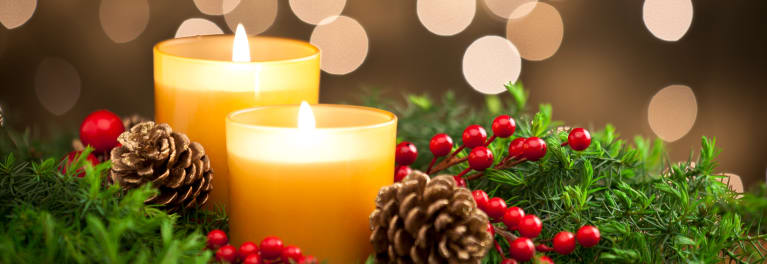A photo of candles burning sets a soothing scene. Relaxation can help with holiday stress.