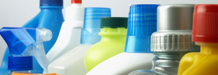Line of spray bottles for home cleaning supplies.