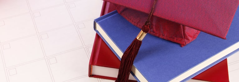 Books and a mortarboard.