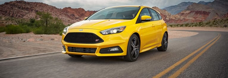 A yellow Ford Focus