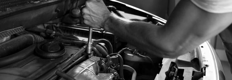 A man working on a car engine.