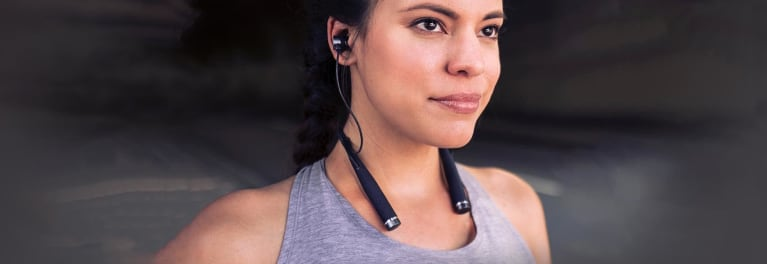 A woman wearing the new Vi headphones for runners