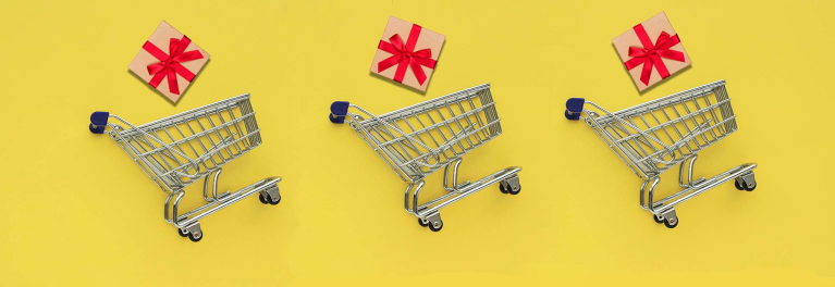 An illustration that shows three gifts floating above three shopping carts.