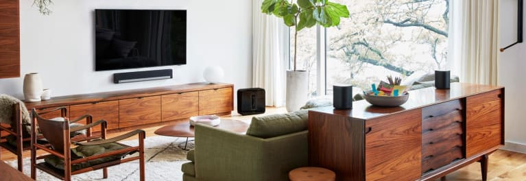 Photo of as living room with various Sonos speakers, including the Sonos One.