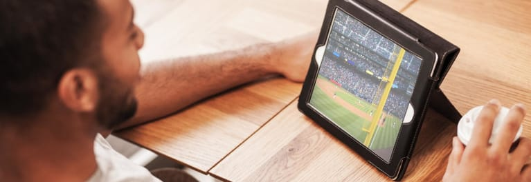 A man watching Major League Baseball playoffs streaming.