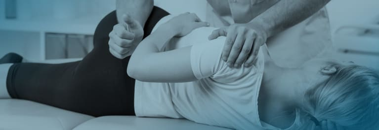 chiropractor performing spinal manipulation for low back pain in a woman