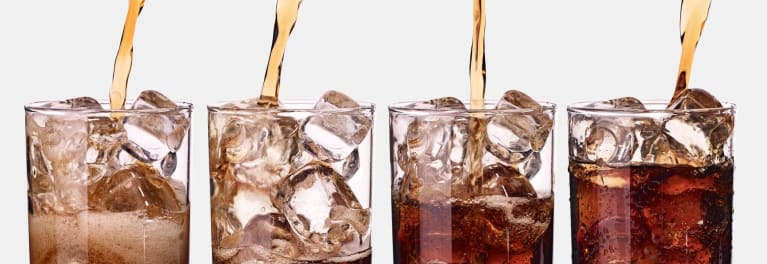 Diet sodas being poured into glasses.