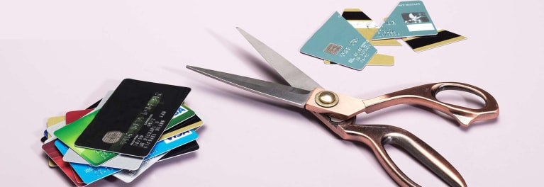 An image of scissors and cut-up credit cards to illustrate canceling a credit card.