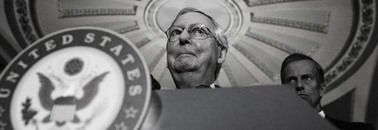 Senate leader Mitch McConnell at a podium.