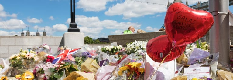 A impromptu memorial to victims of the London terrorist attacks reminds of the need for travel insurance.