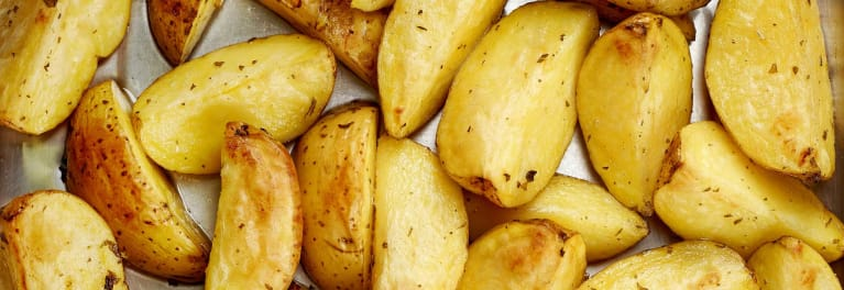 Photo of cooked potato wedges.