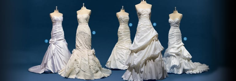 Five wedding gowns on mannequins