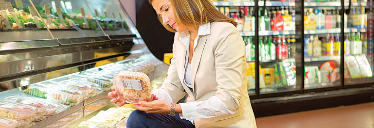 Our expert Amy Keating reading labels of supermarket prepared food.